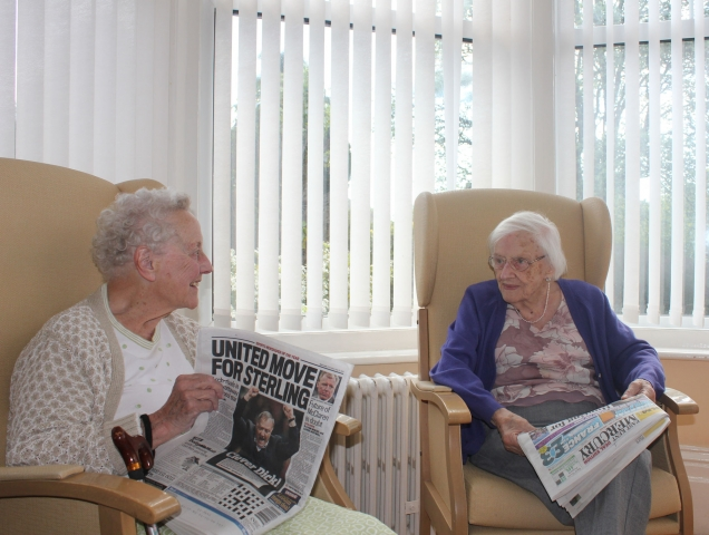 Reading the local papers at Bradfield.